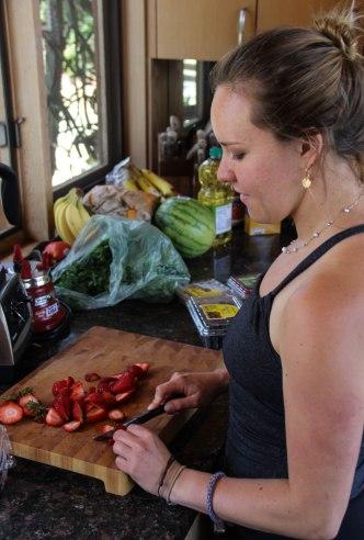chopping strawberries